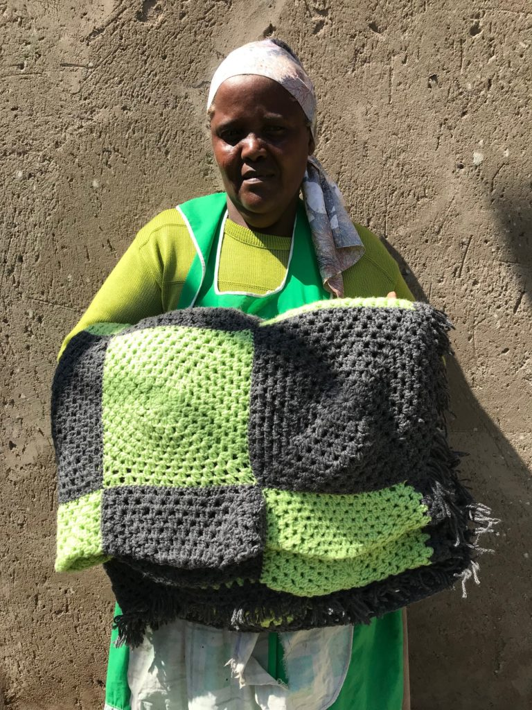 Leonore's crocheted lime green and grey granny square blanket R800.00